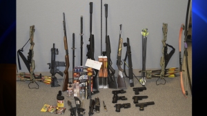 This weapons cache was found at the home of a student who was arrested after allegedly threatening to shoot, stab staff members at Black Rock High School in Yucca Valley, authorities said. (Credit: San Bernardino County Sheriff's Department)