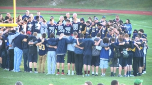 Teammates of Tom Cutinella, a 16-year-old varsity football player from New York who died after colliding with an opponent during a game Oct. 2, 2014, gathered for a vigil. (Credit: CNN)
