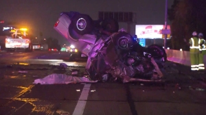 A pickup truck was hit by a wrong-way driver in a white Acura sedan on the 110 Freeway in downtown Los Angeles on Thursday, Nov. 13, 2014, authorities said. (Credit: KTLA)
