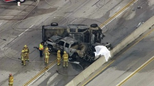 One person was killed in a fiery crash on the 405 Freeway in North Hills on Friday, Nov. 14, 2014. (Credit: KTLA)