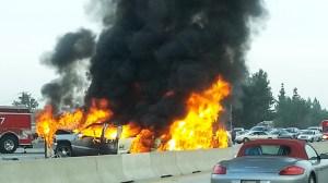 Three vehicles caught fire on the 405 Freeway on Friday, Nov. 14, 2014. (Credit: Melissa McComas)