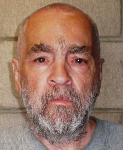 """In this handout photo from the California Department of Corrections and Rehabilitation, Charles Manson poses for a photo on March 18, 2009, at Corcoran State Prison, California. Manson is serving a life sentence for conspiring to murder seven people during the """"Manson family"""" killings in 1969. The picture was taken as a regular update of the prison's files. (Credit: California Department of Corrections and Rehabilitation via Getty Images)"""