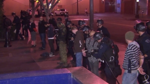 Dozens of demonstrators protesting the Ferguson grand jury's decision to not charge an officer in the shooting death of Micheal Brown were arrested on Nov. 26, 2014. (Credit: KTLA)