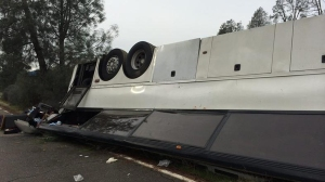 A tour bus reportedly traveling from Los Angeles crashed in Shasta County on Nov. 23, 2014. (Credit: KHSL)