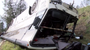 One person was killed and at least 30 others were injured when a tour bus crashed in Northern California on Nov. 23, 2014. (Credit: KHSL)