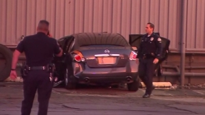 One person was killed after a car crashed into a building in Boyle Heights on Nov. 23, 2014. (Credit: KTLA)