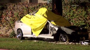 Police and firefighters respond to a fatal crash in Costa Mesa on Nov. 26, 2014. (Credit: OnScene.tv)