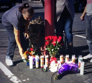 Julie Lopez is seen at a makeshift memorial for her daughter, Daniella Palacios, on Sunday, Nov. 2, 2014. Palacios was fatally struck by a hit-and-run driver in Anaheim the night before. (Credit: Mark Mester/KTLA)