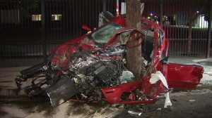 A driver was severely injured when the car he was driving slammed into a pole in downtown Los Angeles on Sunday, Nov. 2, 2014. (Credit: KTLA)