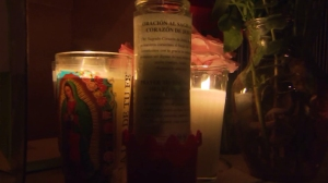 Candles and letters were left at the East L.A. location where two men were shot and killed by L.A. County Sheriff's Deputies on Nov. 16, 2014. (Credit: KTLA)