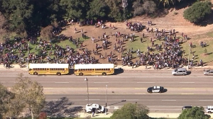 A large crowd is seen outside Palisades High School after the campus was evacuated due to a threat posted on social media on Tuesday, Nov. 4, 2014. (Credit: KTLA)