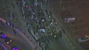 Ferguson grand jury protesters attempted to march onto the 10 Freeway at La Brea Avenue on Monay night. (Credit: KTLA)