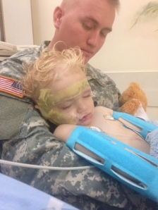 The family of a 1-year-old boy who was attacked by a dog in Riverside County on Nov. 14, 2014, provided this photo. In it the boy is seen at a Riverside County hospital with his father.