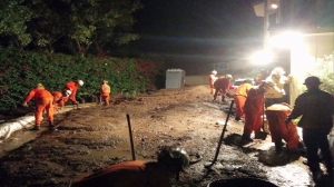Crews worked to remove mud from a Glendora home after heavy rainfall on Nov. 21, 2014. (Credit: KTLA)