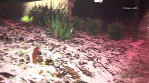 Hail is seen in San Dimas after heavy rainfall the morning of Nov 21, 2014. (Credit: OnScene)