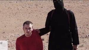 American Peter Kassig is shown at the end of a video in which British aid worker Alan Henning was executed by ISIS.