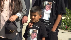 Family members are seen wearing T-shirts honoring Santos Castro at a press conference on Wednesday, Nov. 12, 2014.