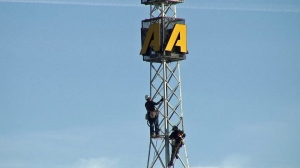Workers climb the KTLA radio tower before its removal on Monday, Nov. 24, 2014. (Credit: KTLA)