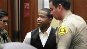 Javier Bolden is escorted back into court last month after a jury found him guilty of first-degree murder in the 2012 shooting deaths of two graduate students who were killed while sitting in a parked car near USC. (Credit: Allen J. Schaben / Los Angeles Times)