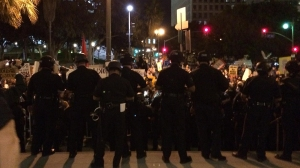 Police faced off with protesters outside LAPD headquarters in downtown Los Angeles on Nov. 25, 2014. (Credit: Nerissa Knight/KTLA)