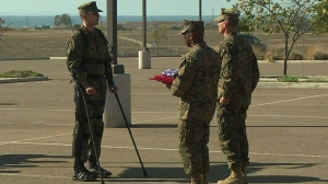 Aided by new technology, Capt. Derek Herrera -- a Marine paralyzed from the chest down by a sniper in Afghanistan -- was able to walk to get his Bronze Star. (Credit: CNN)