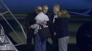 Matthew Todd Miller, who had been held in North Korea since April, greets members of his family after he arrived at Joint Base Lewis-McChord, Wash., on Saturday, Nov. 8, 2014. (Photo via CNN)
