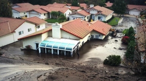 A home sustained major damage after a mudslide in Camarillo on Oct. 31, 2014. (Credit: Mark Mester/KTLA)