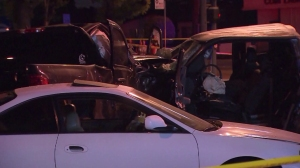 A 70-year-old passenger died after a suspected street racing crash in Paramount on Wednesday, Nov. 12, 2014, authorities said. (Credit: KTLA)
