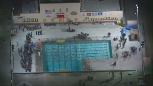 Players were in the water at Don Lugo High School in Chino after a patient was airlifted on Nov. 13, 2014. (Credit: KTLA)