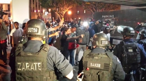 Tensions running high as protesters confront police near 6th and Hope streets in Downtown Los Angeles on Wednesday. (Credit: KTLA)