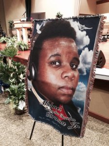 A large memorial photo of slain teenager Michael Brown inside Friendly Temple Missionary Baptist Church in St. Louis, the site of Brown's funeral on Aug. 25, 2014. (Credit: pool)