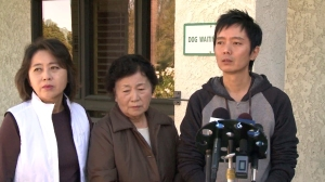 Sunny Oh, Sun Ho Lee and Johnny Lee asked for help finding Sa Lee at a news conference at Laguna Woods City Hall on Nov. 25, 2014. (Credit: KTLA)