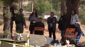 Authorities speak to supporter of James Kretzschmar, an Irvine mountain biker, near the command post for the search for him on Nov. 13, 2014. (Credit: KTLA)