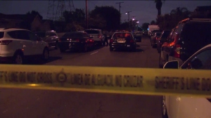 The Los Angeles County Sheriff's Department was investigating the fatal shooting of a man in the Florence-Firestone neighborhood of South L.A. on Nov. 11, 2014. (Credit: KTLA)