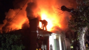 Firefighters extinguished a house fire in the South Pasadena area on Sunday, Nov. 2, 2014.