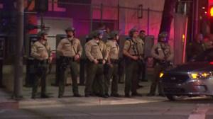 Los Angeles County sheriff's deputies await protesters near the Men's Central Jail on Nov. 26, 2014. (Credit: KTLA)