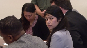 Vanesa Zavala looks back during victim impact statements at her sentencing hearing in a Santa Ana courtroom on Nov. 14, 2014. Her co-defendant, Candace Brito, is in the background. (Credit: KTLA)
