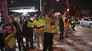 Protesters rally in front of a Wal-Mart in Pico Rivera on Nov. 13, 2014. (Credit: KTLA)