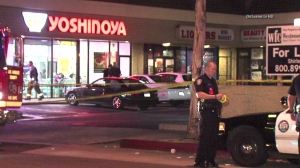 A man was shot and killed outside a fast-food restaurant in Inglewood on Sunday, Nov. 9, 2014, police said. (Credit: OnScene.tv HD)