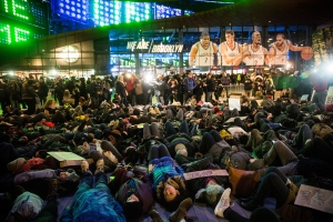 Demonstrators stage a die-in outside the Barclays Center during a Brooklyn Nets game to protest a Staten Island, New York grand jury's decision not to indict a police officer involved in the chokehold death of Eric Garner in July on Monday, Dec. 8, 2014, in New York City. (Credit: Andrew Burton/Getty Images)