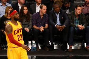 Prince William, Duke of Cambridge and Catherine, Duchess of Cambridge watch as LeBron James of the Cleveland Cavaliers looks on during his game against the Brooklyn Nets at Barclays Center on Monday, Dec. 8, 2014 in the Brooklyn borough of New York City. (Credit: Al Bello/Getty Images)