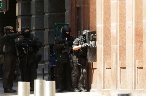 Armed policeman are seen outside Lindt Cafe on Philip St, Martin Place on Monday, Dec. 15, 2014, in Sydney, Australia. (Credit: Mark Metcalfe/Getty Images)