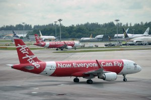 Malaysian low-cost carrier AirAsia aircraft are seen at Changi International Airport in Singapore on May 8, 2014. (Credit: Roslan Rahman/AFP/Getty Images)