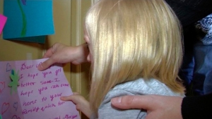 With the help of her older sisters, Shayley and Audree — who hang up the cards — cards for Addie and her sisters are pouring in from family, friends, and as word spreads on social media, even strangers.  (Credit: Sam Penrod, KLS-TV)