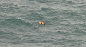 This aerial view taken from an Indonesian search and rescue aircraft over the Java Sea shows floating debris spotted in the same area as other items being investigated by Indonesian authorities as possible objects from missing AirAsia flight QZ8501 on December 30, 2014. (Credit: BAY ISMOYO/AFP/Getty Images)