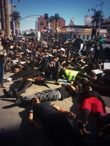 "Participants in the #BlackOutHollywood protest on Dec. 6, 2014, are seen during a ""die in."" (Credit: Mark Mester/ KTLA)"