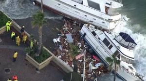 Boats were washed up against the shore in Avalon Harbor on Dec. 31, 2014. (Credit: KTLA)
