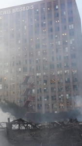 Windows were blown out in the Lewis Brisbois Bisgaard & Smith LLP building in downtown L.A. due to heat caused by a fire inside and in a neighboring building on Dec. 8, 2014. (Credit: Eric Spillman/ KTLA)