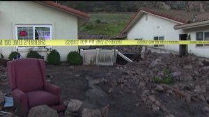 Homes in Camarillo Springs were red-tagged after being damaged in a mudslide on Dec. 12, 2014. (Credit: KTLA)