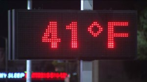 A sign at a Canoga Park gas station indicated a chilly temperature on Saturday, Dec. 27, 2014. (Credit: KTLA)